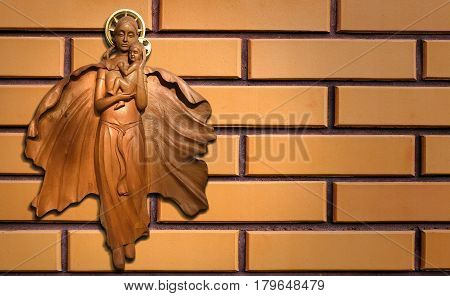 Art Wood Carving Virgin Mary with child Jesus on brick wall