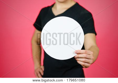 Man showing blank white rounded flyer brochure booklet. Leaflet presentation. Pamphlet hold hands. Man show clear offset paper. Sheet template. Booklet design sheet display read first person.