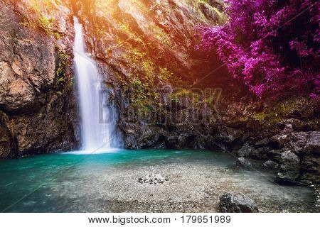 Natural background waterfall. waterfall Colorful leaves. jogkradin waterfall thailand tropical