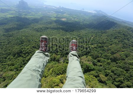freedom legs fly on forest mountain top