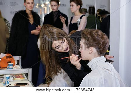 Kyiv, Ukraine - February 6, 2017: Makeup Artist At Work. Backstage Of Ukrainian Fashion Week 2017