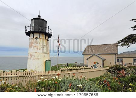 MONTARA CALIFORNIA - MARCH 16 2015: Lighthouse displays and entrance to the Point Montara Lighthouse Hostel off of California Highway 1 approximately 25 miles south of San Francisco on a cloudy day.