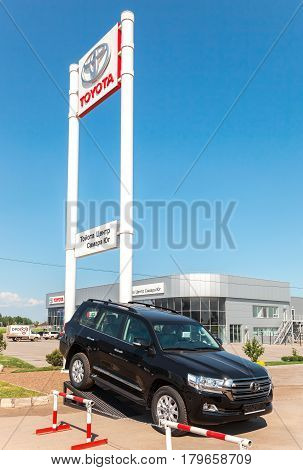SAMARA RUSSIA - MAY 29 2016: Office of official dealer Toyota in summer sunny day. Toyota Motor Corporation is a Japanese automotive manufacturer