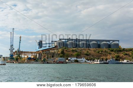 Sevastopol, Russia - June 09, 2016: Granary and cargo port cranes in Sevastopol Bay