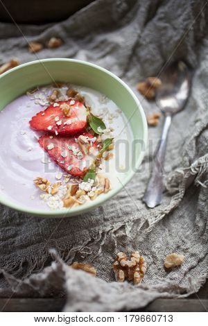 Smoothie bowl with strawberries and walnuts