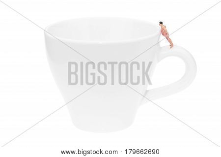 Coffee Cup With Miniature People Figure Isolated On White Background.