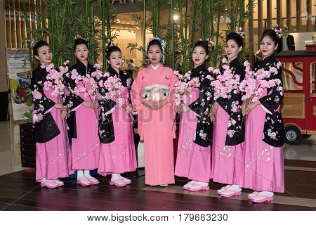 Moscow, Russia - April 02, 2017: Group Of Japanese Geisha Girls In Traditional Kimono In The Shoppin