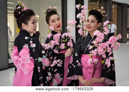 Moscow, Russia - April 02, 2017: Three Geisha In Traditional Japanese Kimono In The Shopping Center