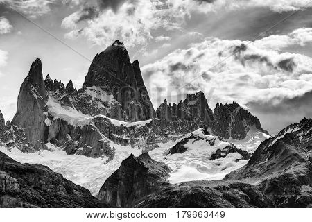 Mount Fitz Roy and its surrounding granite peaks in Patagonia region of Argentina, popular for hiking and trekking. In black and white.
