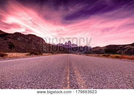 View from highway towards El Chalten and Mount Fitz Roy in the background at sunset's golden hour in Patagonia region of Argentina
