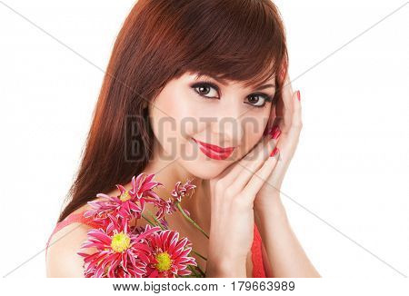 Cute young woman with spring flowers. Care for beautiful woman skin. Cosmetology and makeup at beauty salon. Closeup portrait of smiling woman face with beautiful red flowers