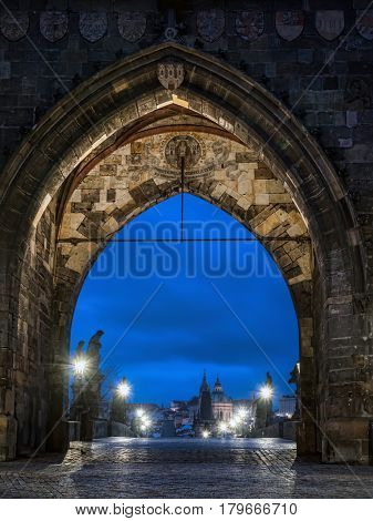 Charles Bridge with one of its tower gates illuminated at night, Prague, Czech Republic