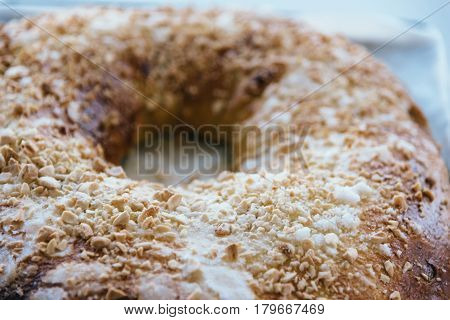 Close Up Of of sweet bread ringed dessert with sugar and almonds. On oven plate Called roscon is typical in spanish cuisine. Horizontal composition