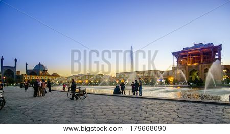Isfahan, IRAN - October 31, 2016: Sunset over Naqsh-e Dschahan Square - Imam Square in Isfahan