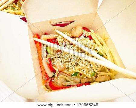 Chinese noodles in a box on a wooden table