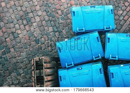 Plastic garbage dumpster containers on the street from above