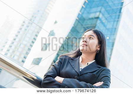 Head and shoulders portrait of smiling Asian business woman on building background. business woman in Bangkok. business woman concept. business woman asian. business woman happy smiling. business woman professional.