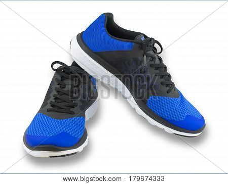 Pair of blue sport shoes on white background. Sport shoes isolated. File contains a clipping path. Sport running shoes isolated on white background. trekking shoes. Sport running shoes blue coler. Sport running shoes closeup.