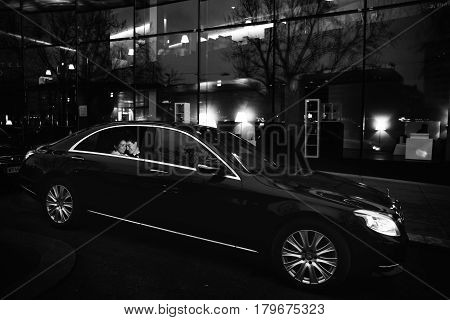 A Picture Of Happy Wedding Couple Sitting In The Black Mercedes