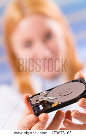 HDD in young woman hand