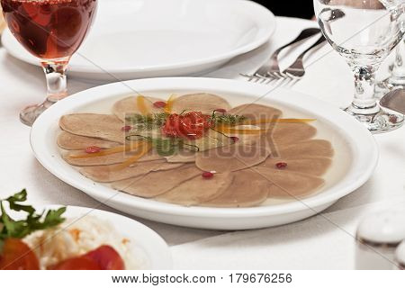 On a table there is a dish with aspic
