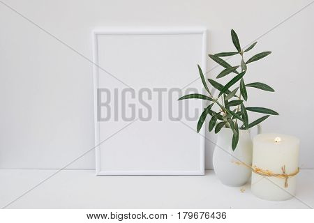 Frame mockup on white background olive tree branches in ceramic pitcher candle styled image for social media marketing blogging