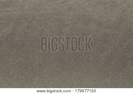 abstract background and speckled or mottled texture of fabric or textile material of beige color