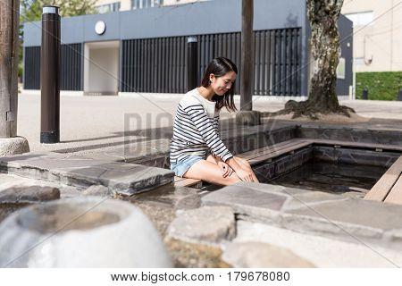 Woman enjoy foot onsen