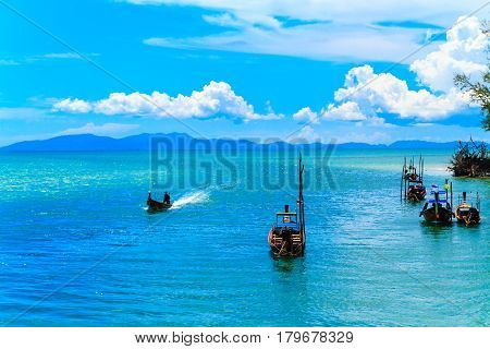 The long tail boat and Fishing village with blue sky In Sikao Thailand.