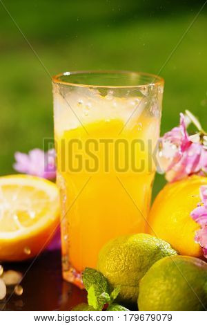 Photography of a orange juice, flowers and fruits
