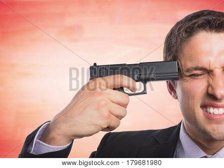 Digital composite of Business man with gun to head against blurry red wood panel