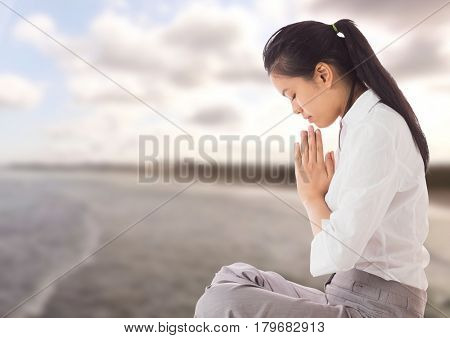 Digital composite of Woman Praying yoga Meditating by sea