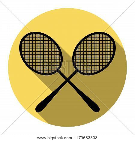 Tennis racquets sign. Vector. Flat black icon with flat shadow on royal yellow circle with white background. Isolated.