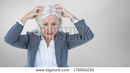 Digital composite of Stressed older woman against grey background
