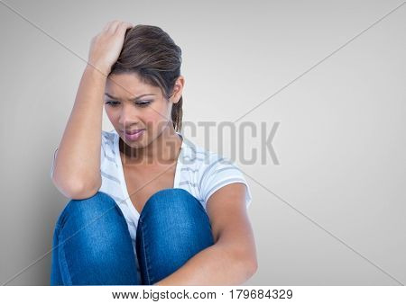 Digital composite of Stressed woman against grey background