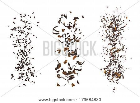 Falling dried tea leaves isolated on white background.