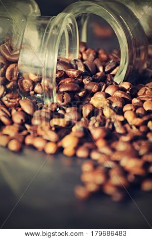 Scatter beans of coffe from glases. Background for hot drink.