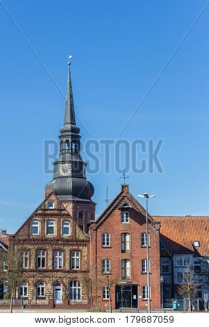 STADE, GERMANY - MARCH 27, 2017: Tower of the Cosmas and Damian church over houses in Stade, Germany