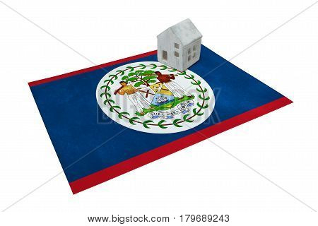 Small House On A Flag - Belize