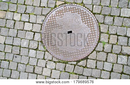 Manhole Cover On Pavement At Schaffhausen City. Switzerland