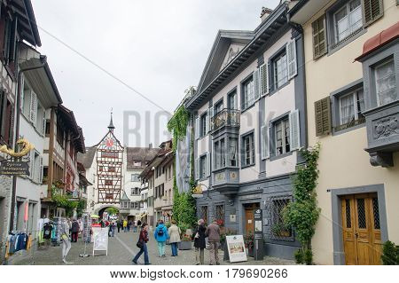 Tourists Walk At Medieval Town Stein Am Rhein. Schaffhausen Canton. Switzerland