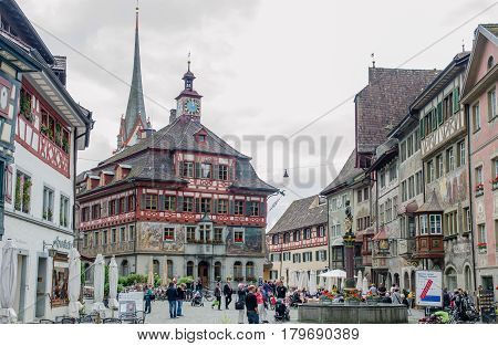 Tourists Walk On Main Square At Medieval Town Stein Am Rhein. Schaffhausen Canton. Switzerland