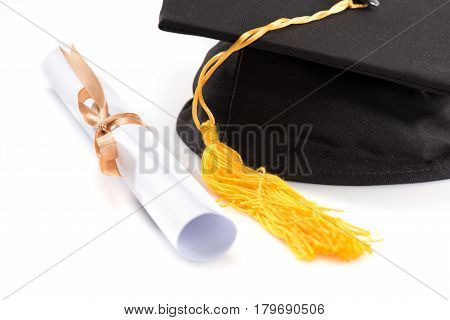 Close-up View Of Graduation Mortarboard And Diploma On White, Education Concept