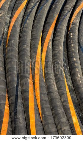 Some black and orange hydraulic hoses lines