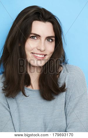 Happy and beautiful young woman smiling studio shot