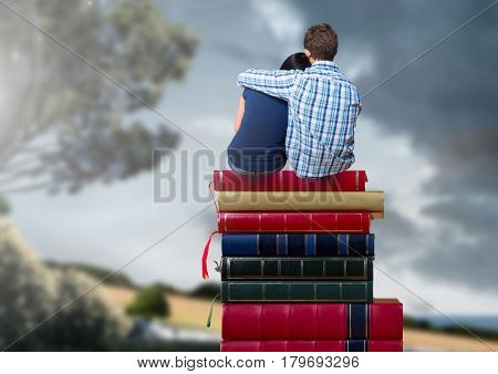 Digital composite of Couple sitting on Books stacked by romantic nature landscape
