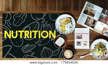 Breakfast meal on a wooden table and blackboard with vegetable icon