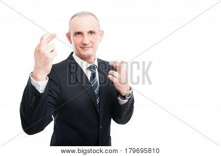 Middle Aged Elegant Man Making Double Fingers Crossed Gesture