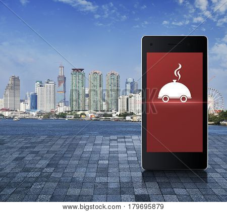 Restaurant cloche flat icon on modern smart phone screen on stone tile floor over office city tower river and blue sky Food delivery concept
