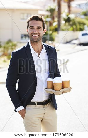 Handsome Coffee cup guy smiling in street